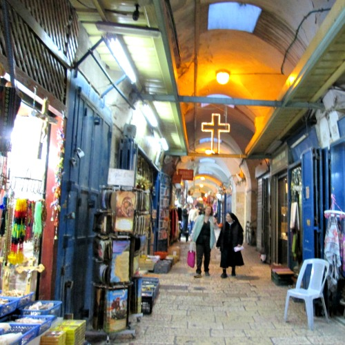 Christian shopkeepers in the Old City of Jerusalem say tourism is way down. The alleyways leading to the Church of the Holy Sepulcher are much less crowded than usual at this time of year.