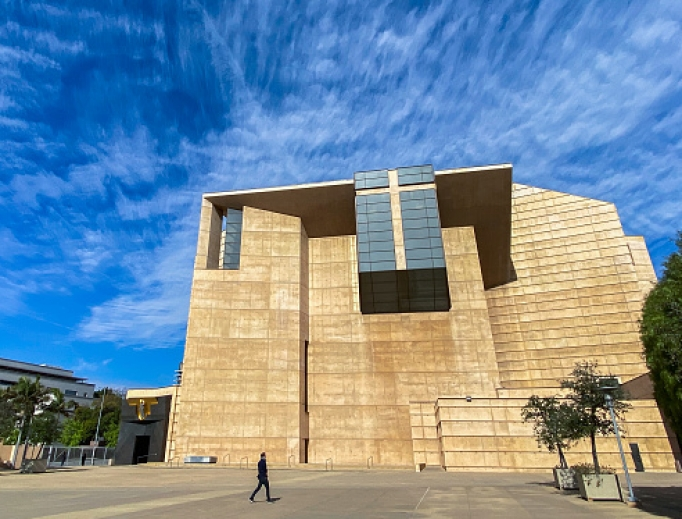 A man walks outside of the Cathedral of Our Lady of the Angels with the church doors closed to the public while Archbishop José Gomez leads a Sunday Mass, streamed online, March 22 in Los Angeles.