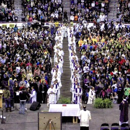 Priests process to the altar during the during the Youth Rally and Mass for Life at the Verizon Center in Washington Jan. 24. Young people from across the nation packed the arena for the events held in advance of the annual March for Life.