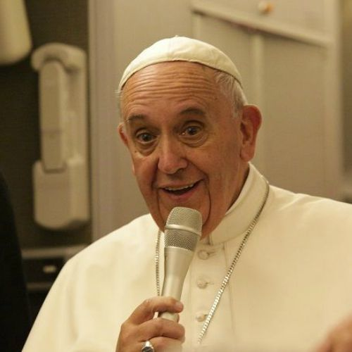 Pope Francis speaks to journalists aboard his flight from Philadelphia to Rome on Sept. 27.
