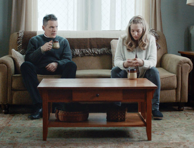 Ethan Hawke and Amanda Seyfried in a scene from First Reformed.