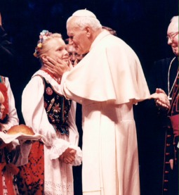 Pope John Paul II greets a girl at World Youth Day 1993 in Denver.