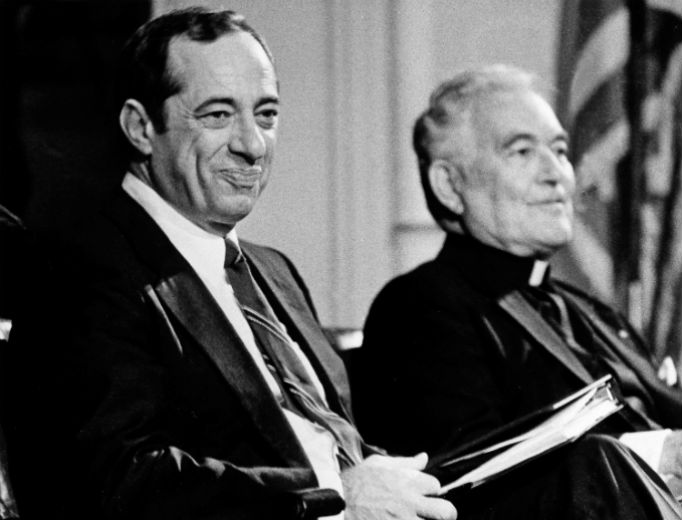 Holy Cross Father Theodore Hesburgh, the president of the University of Notre Dame, sits with New York Gov. Mario Cuomo, left, prior to Cuomo's lecture to students at the Notre Dame campus in South Bend, Indiana, Sept. 13, 1984.