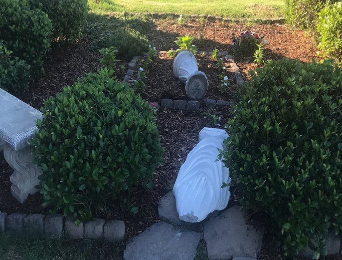 A statue of the Virgin Mary decapitated on the grounds of St. Stephen's Catholic church in Chattanooga.