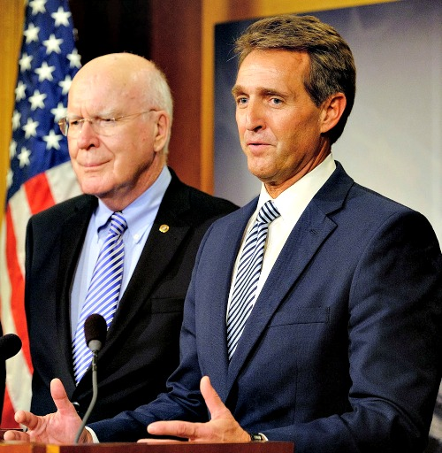 Sen. Jeff Flake (r), R-Ariz., with Sen. Patrick Leahy, D-Vt., discusses the efforts to retrieve U.S. contractor Alan Gross from prison in Cuba on Dec. 17 in Washington.