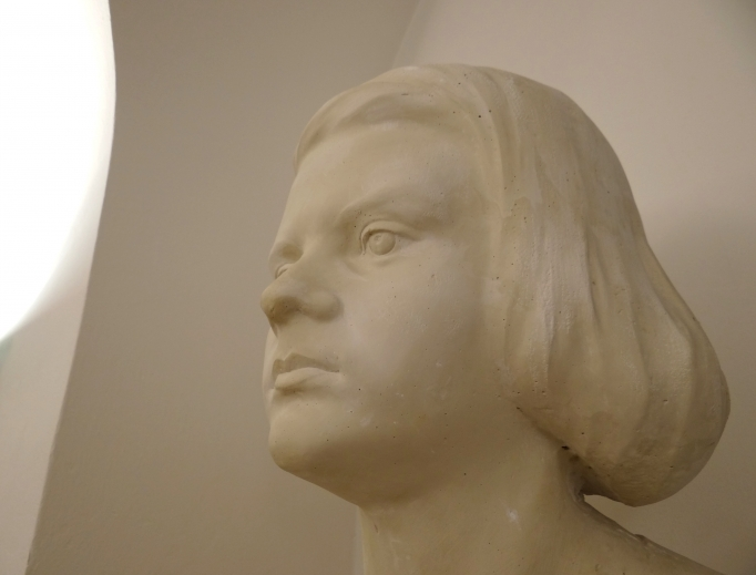 A bust of Sophie Scholl (above) greets visitors at the museum about her at Munich University. Literature (below) produced by the 'White Rose' student resistors is embedded in Scholl Siblings Square.