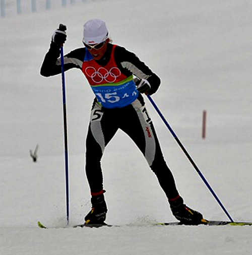 Rebecca Dussault competes in the cross-country skiing event at the 2006 Winter Olympics in Turin, Italy.