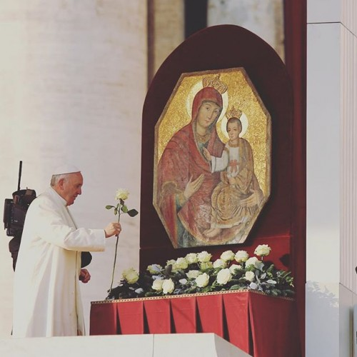 Pope Francis offers a flower to Mary and Jesus on Dec. 9.