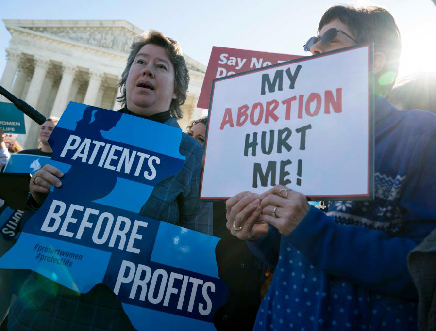 Pro-life activists participate in a rally outside of the Supreme Court as the justices hear oral arguments in the June Medical Services v. Russo case Wednesday in Washington. The Louisiana abortion case is the first major abortion case to make it to the Supreme Court since Donald Trump became president.