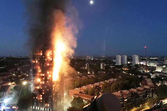 Fire engulfs the 24-story Grenfell Tower in London in the early hours of June 14.