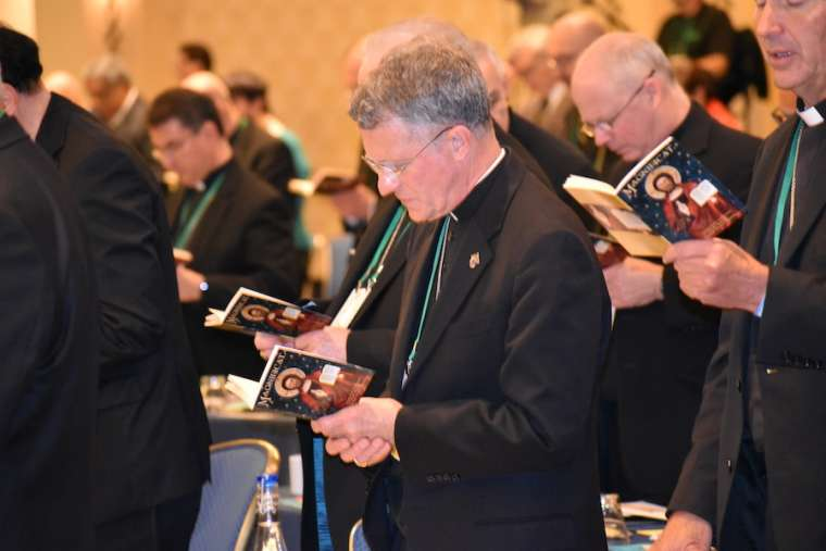 The U.S. bishops pray at their fall meeting in Baltimore