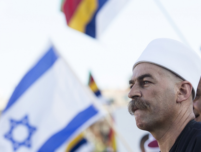 A Druze man in traditional clothing is seen during a protest in Rabin Square Aug. 4 in Tel Aviv, Israel. The rally organized by Druze community members was in protest of a law that declares Israel the exclusive homeland of the Jewish people.