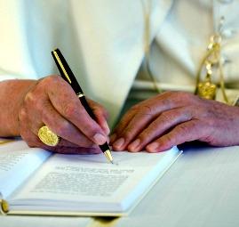 Pope Benedict XVI signs his third encyclical 'Caritas in Veritate.'