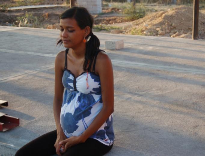 A young woman in Oaxaca, Mexico, 8 months pregnant.