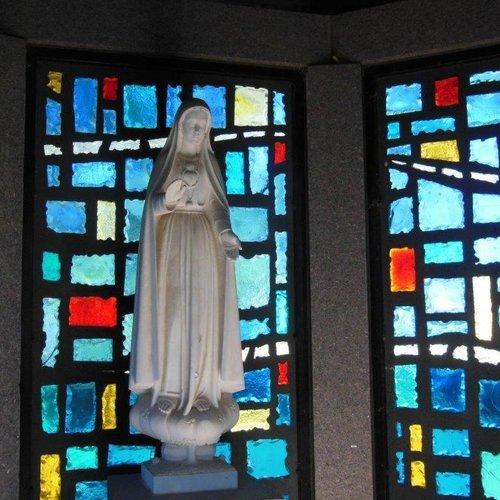 Fatima statue replica, shrine sign and the John Paul II and martyrs' shrine.