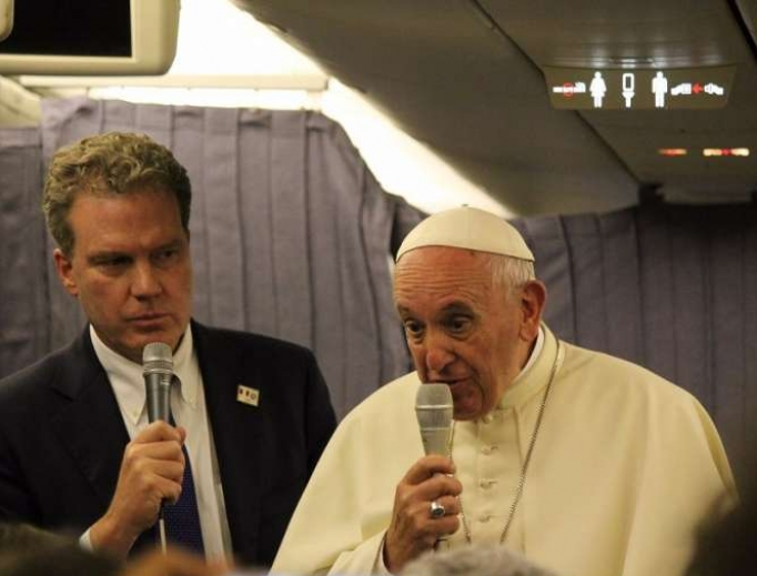 Pope Francis speaks aboard the papal plane from Lima, Peru, to Rome Jan. 22.