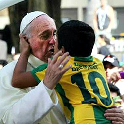 Pope Francis embraces Nathan de Brito during World Youth Day.