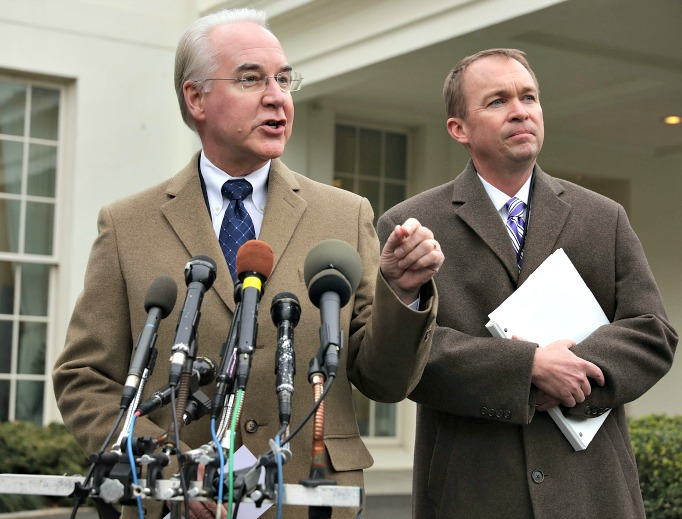 U.S. Health and Human Services Secretary Tom Price (l) and Office of Management and Budget Director Mick Mulvaney talk to reporters following the release of the Congressional Budget Office report on the proposed American Health Care Act outside the White House West Wing March 13.