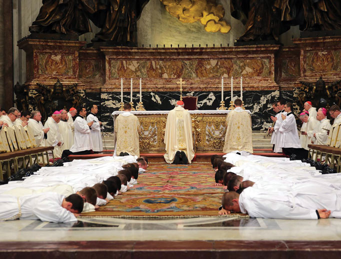 Above, Cardinal Sean Patrick O'Malley of Boston celebrates the ordination of deacons from the Pontifical North American College in Rome at St. Peter's Basilica Sept. 29, 2016. Below, Bishop Arthur Bishop Serratelli poses with the six men of various backgrounds, life experiences and ages whom he ordained to the priesthood of the Diocese of Paterson, New Jersey, June 19, 2010, in the Cathedral of St. John the Baptist in Paterson. The priests are (from left): Father Benjamin Williams, Father Stephen Sniscak, Father Brian Quinn, Father Amadito Flores, Father Manuel Guevara and Father Daniel O'Mullane.