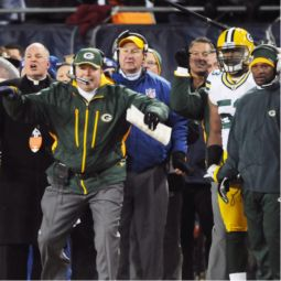 CHEERING ON THE TEAM. Father Jim Baraniak on the sidelines next to Packers head coach Mike McCarthy in Chicago during the NFC game against the Chicago Bears.