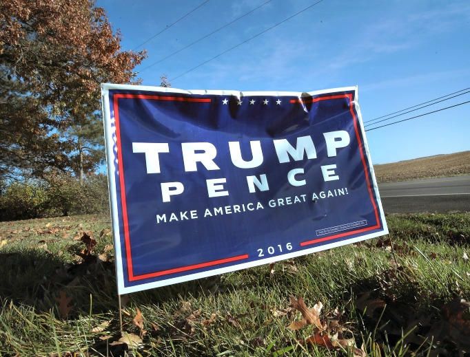 A campaign sign showing support for President-elect Donald Trump sits along a rural highway on Nov. 9 near Belvidere, Illinois. Below, Trump and his campaign manager, Kellyanne Conway, a Catholic.