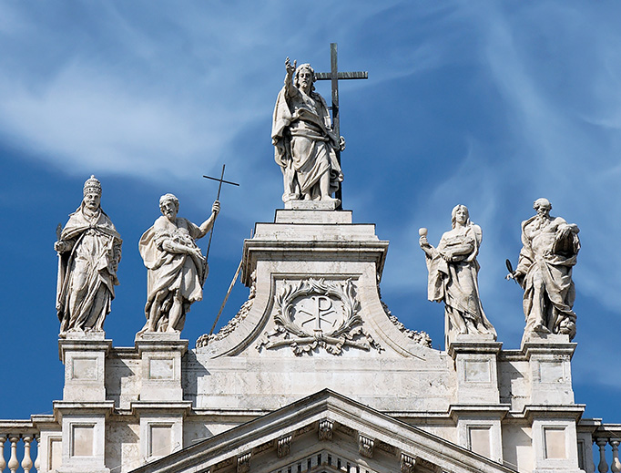 Statue of Our Lord surrounded by St. John the Evangelist, St. John the Baptist and Doctors of the Church, at the Basilica of St. John Lateran in Rome.