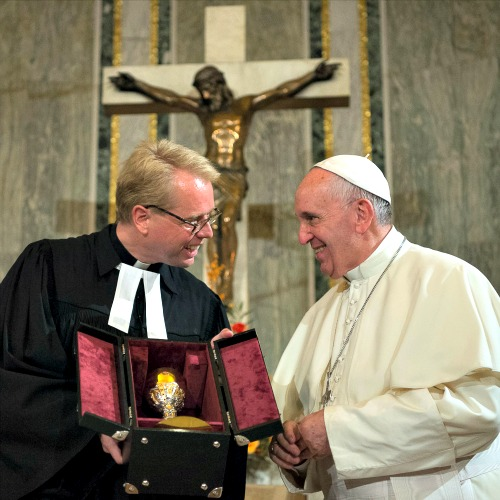Pope Francis meets with Rev. Jens-Martin Kruse at Rome's Evangelical Lutheran Church on Nov. 15.