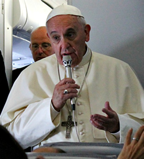 Pope Francis speaks with journalists aboard the plane from Manila to Rome on Jan. 19.