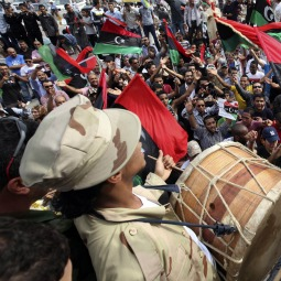 Libyans celebrate at Martyrs square in Tripoli Oct. 20 after hearing the news that Libyan leader Moammar Gadhafi was killed in Sirte.