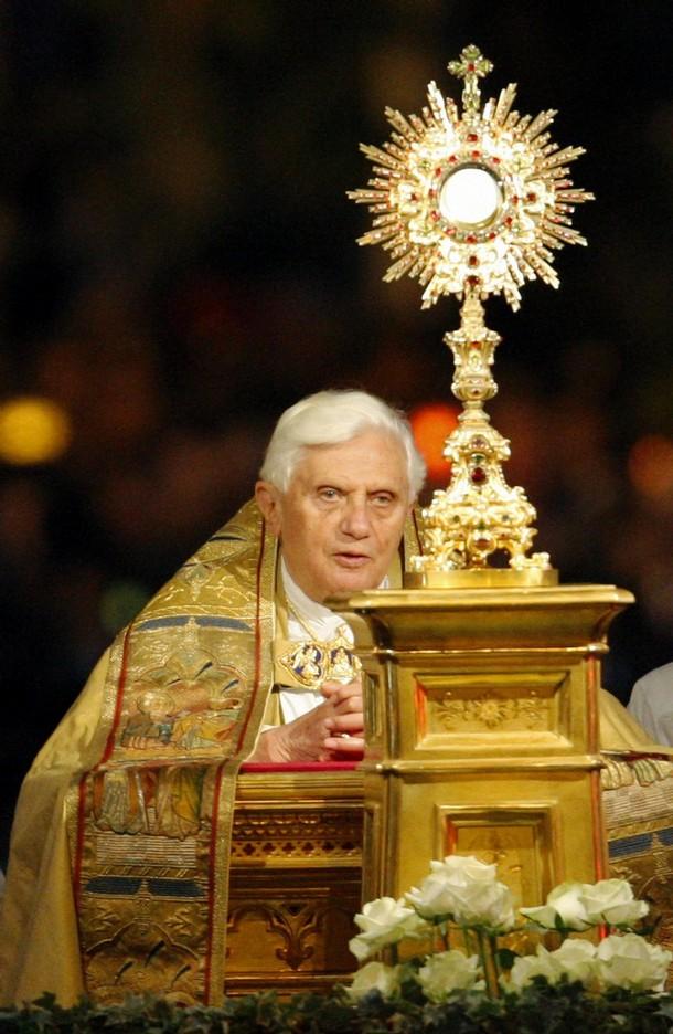 Pope Benedict XVI is adoring the Eucharist!