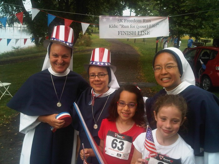 Sisters of Life with race participants.