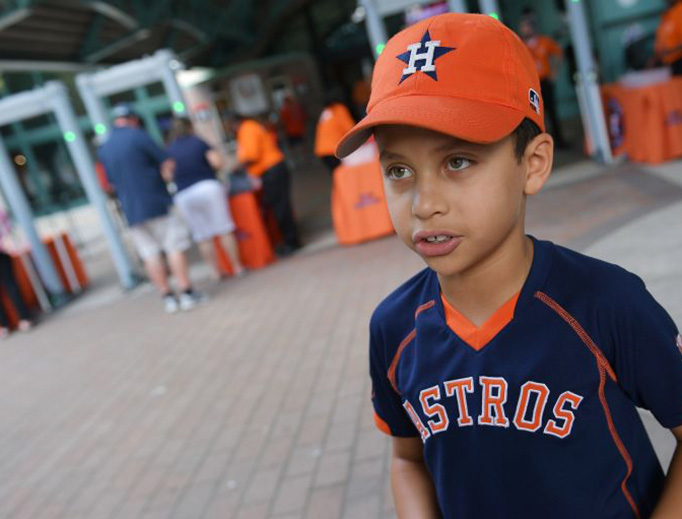 Houston Astros fan Hector Francia speaks outside Minute Maid Park before the second game of a doubleheader between the Astros and the New York Mets Sept. 2, 2017.