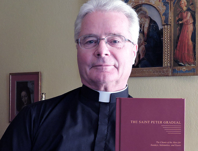Fr. Carl Reid holds the new St. Peter Gradual