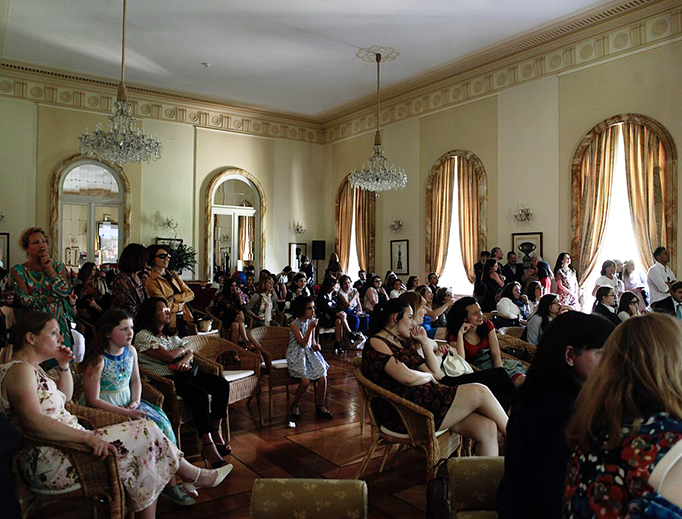 A group in Rome gathers to watch the Royal Wedding