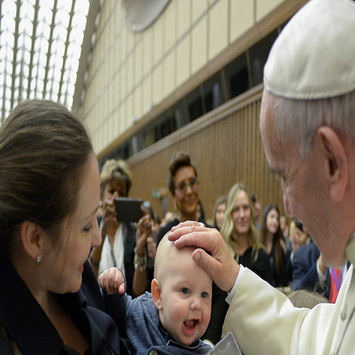 Pope Francis greets a mother and baby at the International Conference on Regenerative Medicine in Vatican City on April 29.