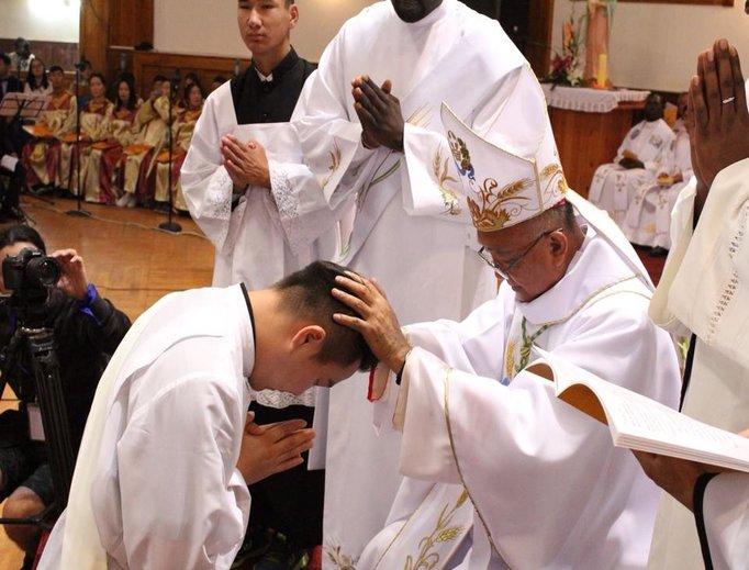 Above, Bishop Wenceslao Selga Padilla ordains Father Joseph Enkh-Baatar; below, Father Enkh-Baatar offers blessings.