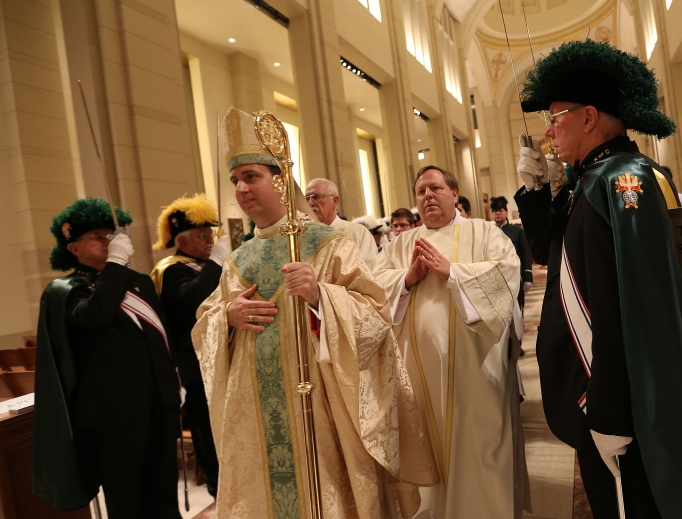 Bishop Steven J. Lopes recesses out of the sanctuary after his ordination to be the first bishop of the Personal Ordinariate of the Chair of St. Peter at the Co-Cathedral of the Sacred Heart on Feb. 2 in Houston.