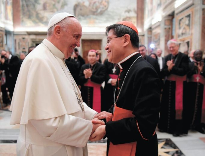 Cardinal Luis Tagle, shown meeting with Pope Francis on Nov. 17, 2016, in Vatican City, is the new head of the Congregation for the Evangelization of Peoples.