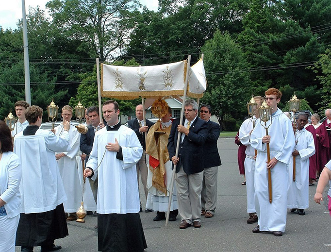 ABOVE: Fr. Brian Gannon carries the Blessed Sacrament in a procession to mark the Solemnity of Christ the King, escorted by the Sons of Saint Joseph. — BELOW: The Sons of Saint Joseph at St. Theresa Church in Trumbull, Connecticut. (Photos courtesy of Fr. Brian Gannon)