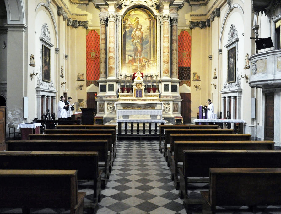 A priest and seminarians pray the Liturgy of the Hours in the empty Church of San Sebastiano on March 13, 2020, in Livorno, Italy. In Italy, public Masses have been suspended to slow the spread of the coronavirus. The number of confirmed COVID-19 cases in Italy has passed 21,000 with the death toll rising to 1441.