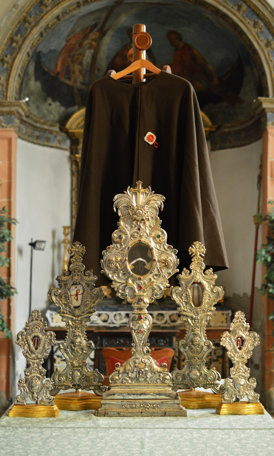 The relics include a glove (right) worn by Padre Pio