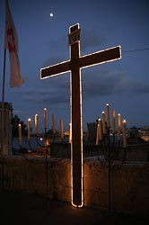 A lighted cross stands at the edge of the Grand Harbor in Valletta, Malta in March 2007.