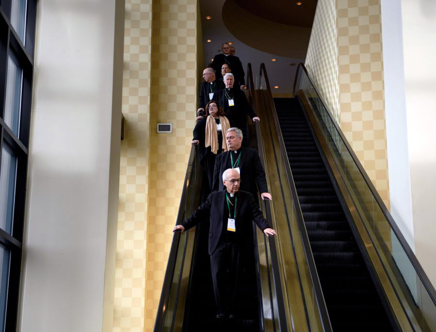 Bishops are seen between an opening session and a prayer session during the annual US Conference of Catholic Bishops, Nov. 12, 2018, in Baltimore, Maryland.