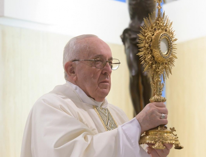 Pope Francis exposes the Blessed Sacrament during Mass on April 16, 2020.