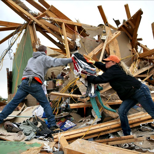 Volunteers help clean debris at the site of a home that was destroyed after a tornado April 29 in Vilonia, Ark. Deadly tornadoes ripped through the region April 27, leaving more than a dozen dead.