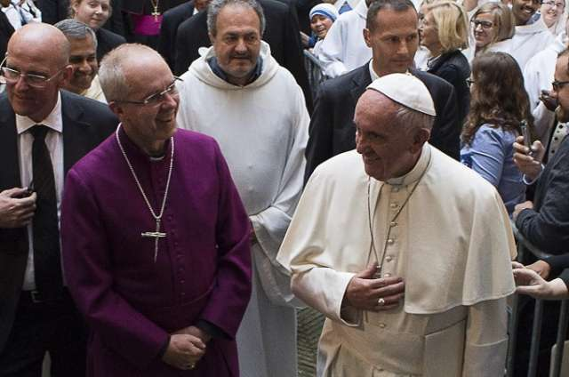 Pope Francis and Anglican Primate Archbishop Justin Welby walk into the Church of San Gregorio al Cielo to pray First Vepsers together.
