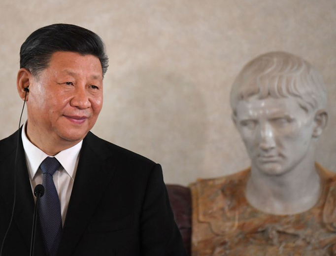 Chinese President Xi Jinping stands next to a bust of Caesar Augustus as he addresses a forum of businessmen on March 22, 2019, at the Quirinale presidential palace in Rome, as part of a two-day visit to Italy.