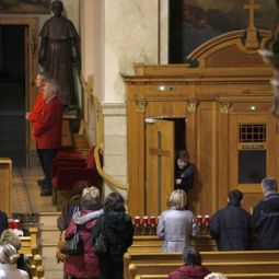 Parishioners wait in line for confession at St. Hyacinth Basilica in Chicago.