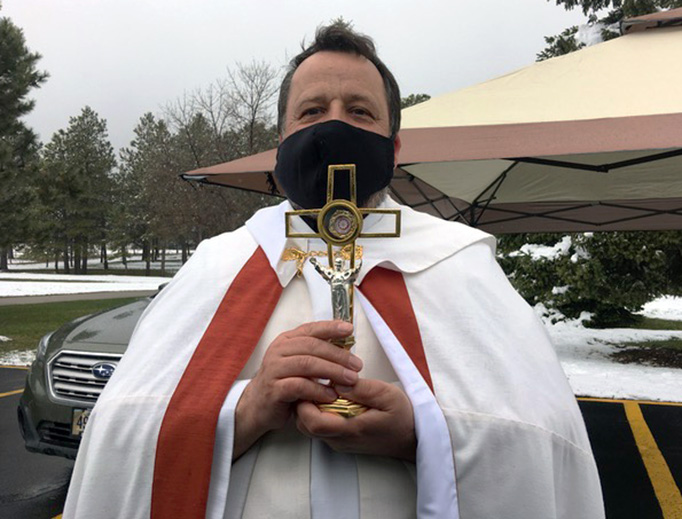 """ABOVE AND 3RD INSET: Father Andrzej Wyrostek at Our Lady of the Black Hills in Piedmont, South Dakota, holds a """"drive-through blessing"""" on Divine Mercy Sunday (Photos courtesy of Pamela Weaver). 1ST AND 2ND INSETS AND BOTTOM: St. Ann's Catholic Church in Clayton, North Carolina, offers """"Divine Mercy Drive-In Holy Hour"""" Sunday (Caitlin Rose Photography)."""