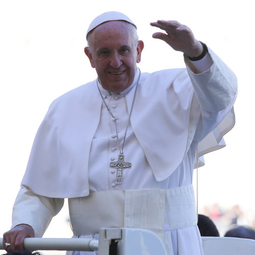 Pope greets the faithful at March 2 audience.